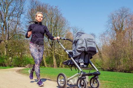 27462774-young-mother-jogging-with-a-baby-buggy